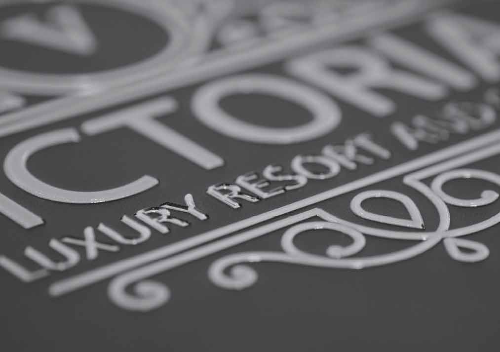 Build up text with gloss ink to add a touch of luxury