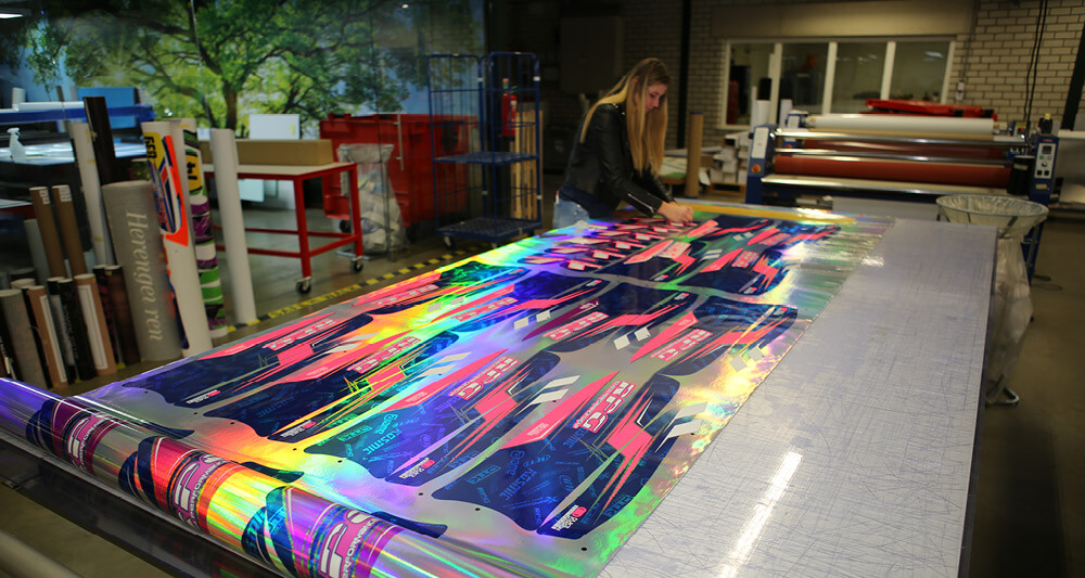 Gielen Reclame achieve stunning results printing on mettalic foils for motor sport companies