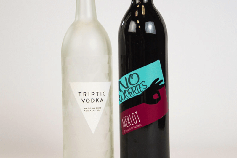 printing labels on cylindrical glass bottles