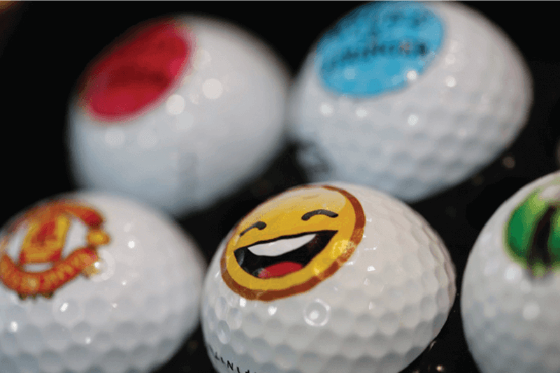 Machines for printing logos and images on golf balls