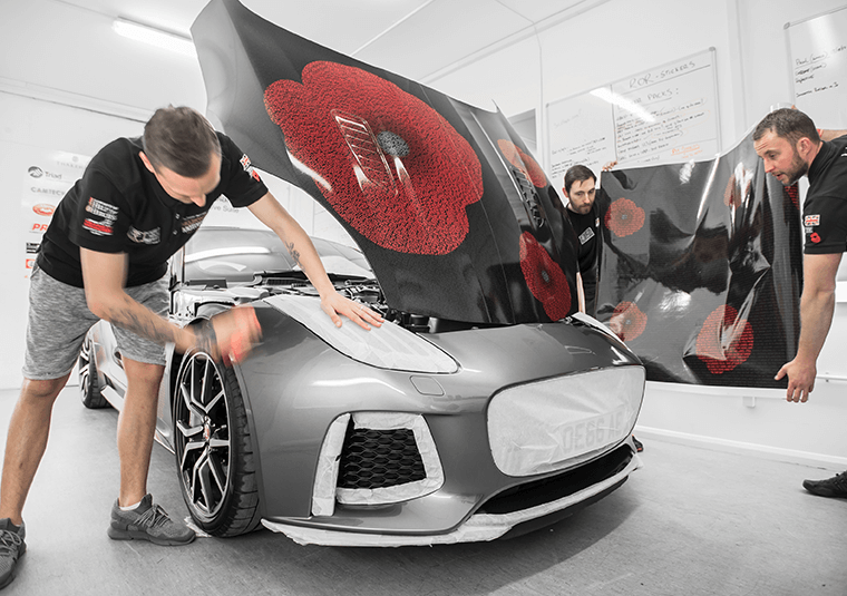 Mission Motorsport team wrapping a Jaguar F-Type