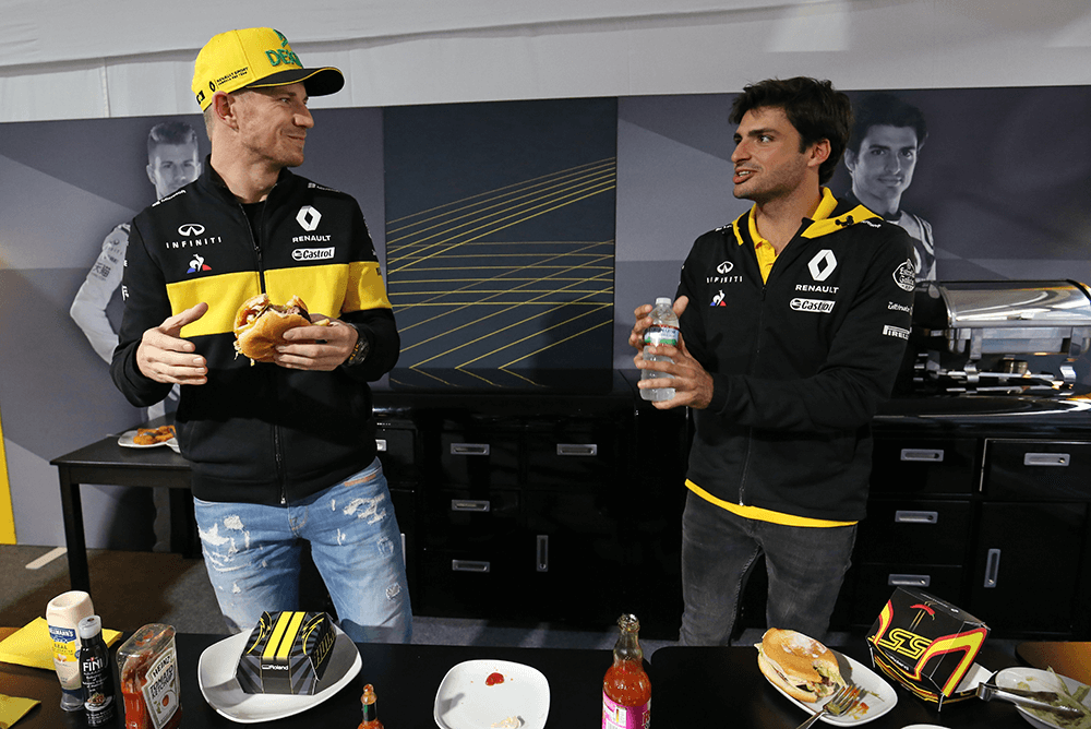 hulkenberg and sainz with burgers