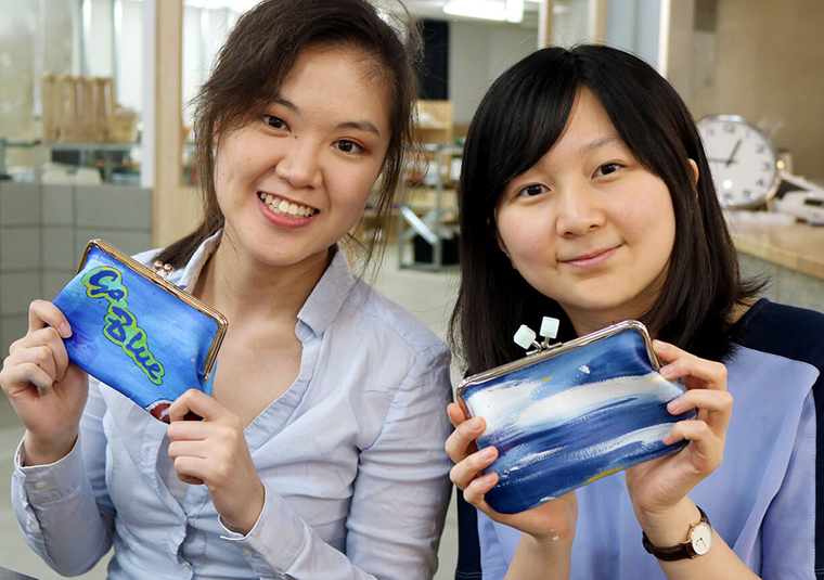 Two international students from the University of Michigan King Yuk Chiu (right) and Jinyu Wang (left) attended a Roland DG internship programme
