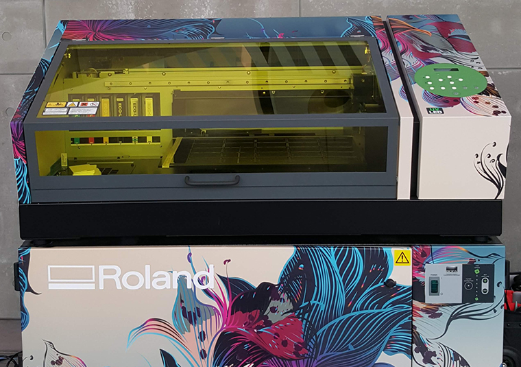 Adobe hosted the popular Roland VersaUV LEF printer on its stand