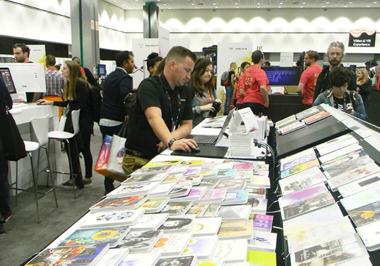 Roland's Garrett Smawley printed thousands of delegates' designs onto notebooks using VersaWorks 6 RIP software at Adobe Max 2018.