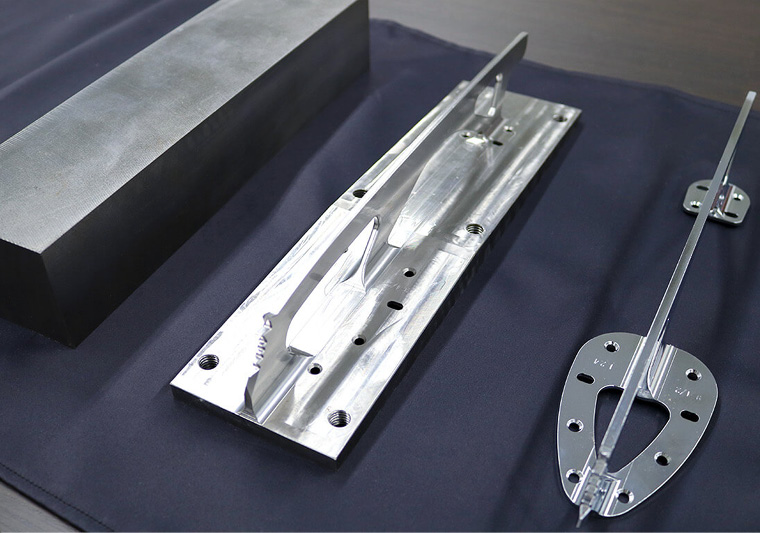 A steel block weighing over 10kg (left) is milled to create the finished blade (right) weighing just 270g