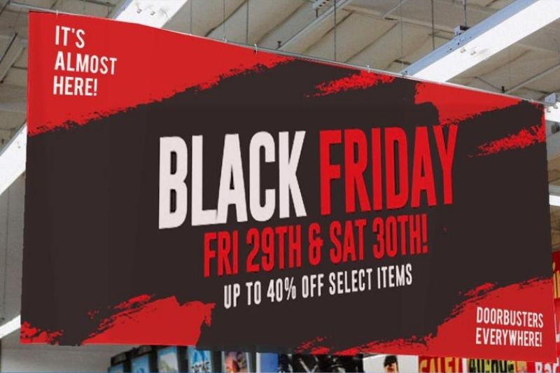 Black Friday sale banner printed in red and black ink and hanging from ceiling
