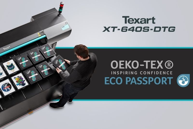 man standing by Texart XT-640S-DTG printer designed t-shirts ECO PASSPORT by OEKO-TEX certified logo