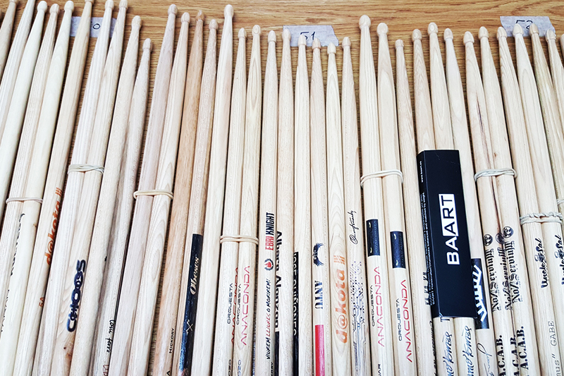 BAART prints logos, names and designs onto its handmade drumsticks