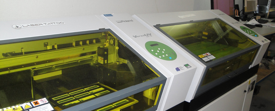 Laser Tattoo runs two VersaUV LEF printers alongside its engraving kit