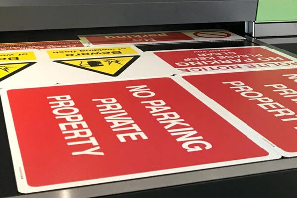 Various warning signs on flatbed UV printer