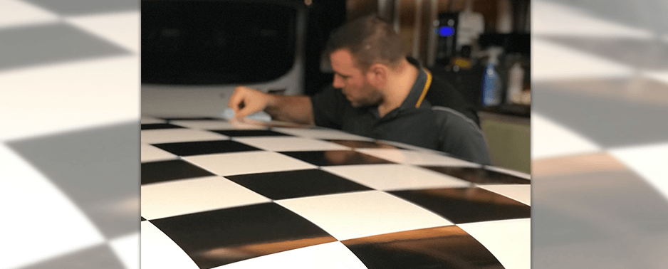 Applying chequered graphic to the roof of a car