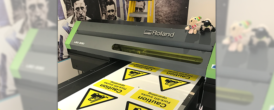 Flatbed UV printer with health and safety signs