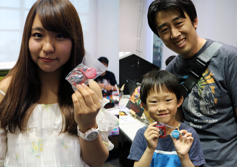 LIMITS Digital Art Battle - visitors showing off their one-of-a-kind key chains