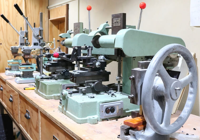 Various equipment used for fabricating frames lined up at the studio