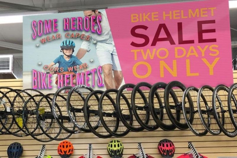 bike helmet sale two days only sale banner hanging in cycling shop