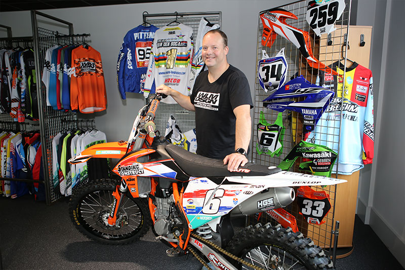 "Wisja Lamers in the showroom of WLM Design with the motocross bike on which Glenn Coldenhoff was victorious in the 2019 Motocross of Nations. ""MX stickers have to take a beating,"" says Lamers."