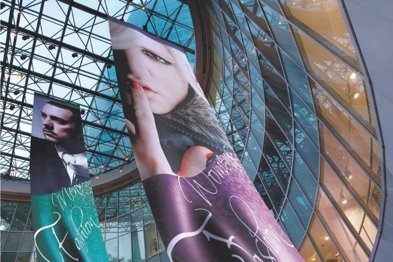 Hanging dye-sublimated soft signage banner in shopping centre promoting fashion store