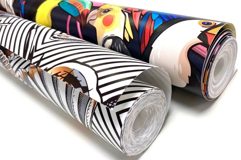 Two rolls of printed wallpaper abstract patterns monochrome and full colour