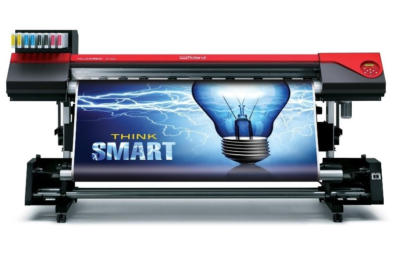 Roland VersaEXPRESS RF-640 with take-up unit and smart light bulb image printed on the front of the media