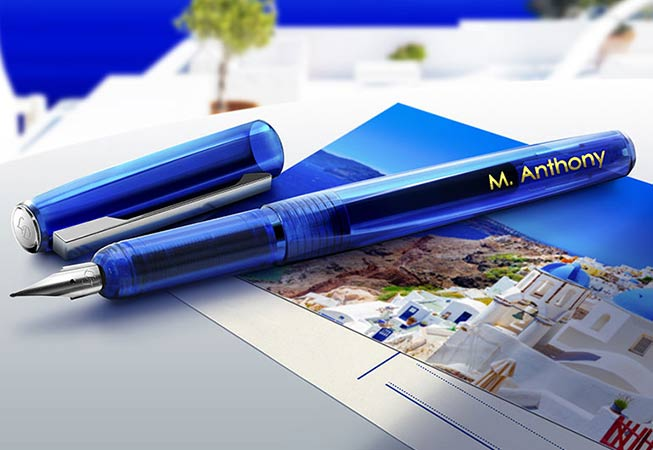 blue fountain pen with name decorated in gold foiling