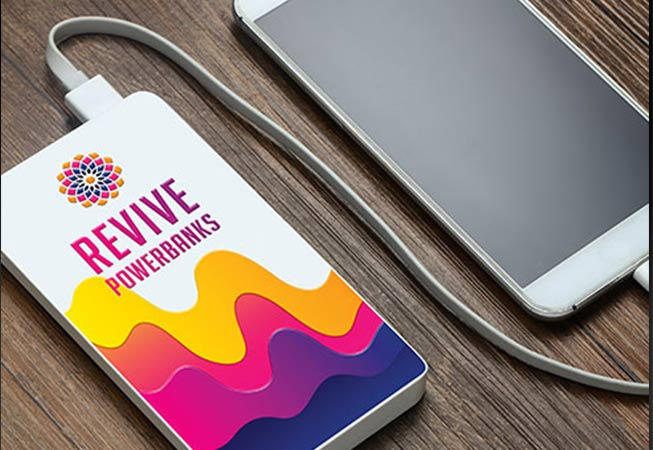 Revive Powerbank showing UV printed logo and yellow, orange, pink and purple colourful design
